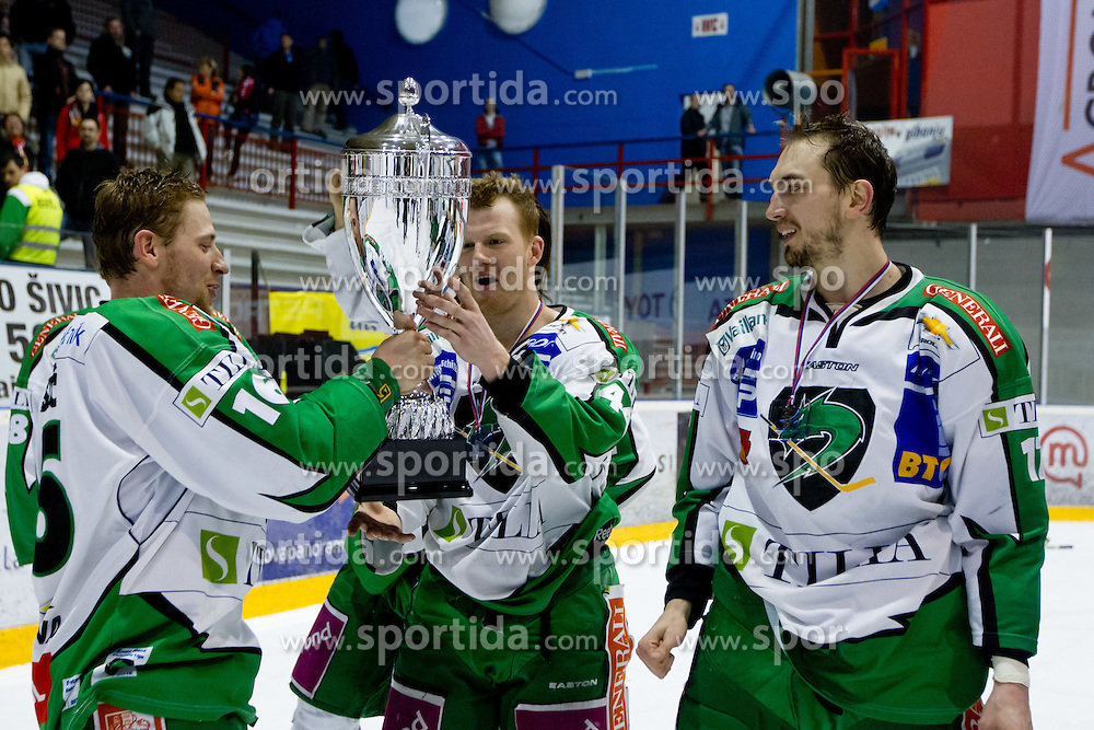 Players of HDD Tilia Olimpija with trophy after ice-hockey match between HK Acroni Jesenice and HDD Tilia Olimpija in fourth game of Final at Slovenian National League, on April 2, 2012 at Dvorana Podmezaklja, Jesenice, Slovenia. HDD Tilia Olimpija won 5:2 and become national champions in season 2011/12. (Photo By Matic Klansek Velej / Sportida.com)