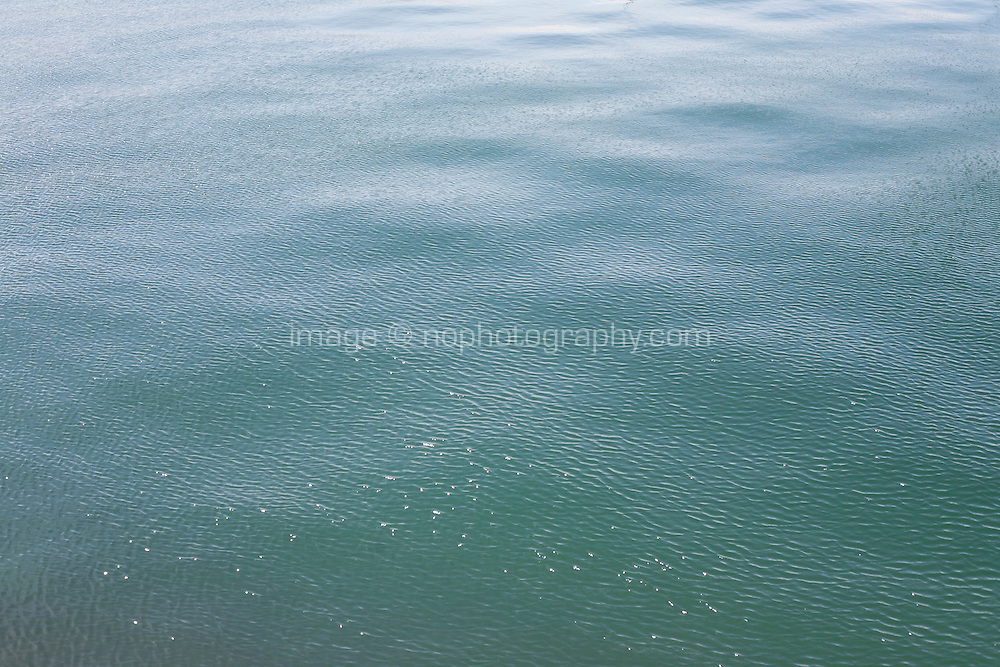 Rippled texture of a calm sea inside Dun Laoghaire Harbour in Dublin Ireland