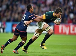 Eben Etzebeth of South Africa looks to get past Shalom Suniula of the USA - Mandatory byline: Patrick Khachfe/JMP - 07966 386802 - 07/10/2015 - RUGBY UNION - The Stadium, Queen Elizabeth Olympic Park - London, England - South Africa v USA - Rugby World Cup 2015 Pool B.
