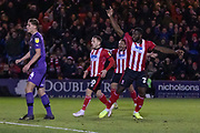 GOAL - John Akinde (29) scores the only goal during the EFL Sky Bet League 1 match between Lincoln City and Tranmere Rovers at Sincil Bank, Lincoln, United Kingdom on 14 December 2019.
