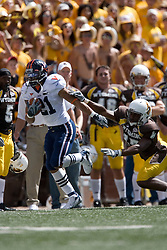 Virginia wide receiver Andrew Pearman (21) beats Wyoming cornerback Keith Lewis (17) on a kick return.  The Wyoming Cowboys defeated the Virginia Cavaliers 23-3 at War Memorial Stadium in Laramie, WY on September 1, 2007.