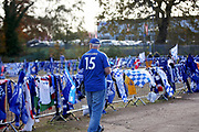 Foxes fan arriving at The King Power Stadium and looking at all the memorial shirts before the Premier League match between Leicester City and Burnley at the King Power Stadium, Leicester, England on 10 November 2018.