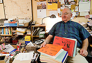 Jack Smalling looks over old copies of Baseball Blue Book's Year & Notebook at his house in Ames, Iowa on Tuesday July 21, 2009.