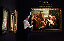 © under license to London News Pictures. Titian's A Sacra Conversazione: The Madonna and Child with Saints Luke and Catherine of Alexandria for sale in New York on 27/01/11. Sotheby's sale of Old Master & British Paintings in London and New York, photographed at Sotheby's on 03/12/10 Photo credit should read: Olivia Harris/ London News Pictures