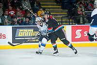 KELOWNA, CANADA - DECEMBER 3: Jesse Lees #2 of Kelowna Rockets checks Nolan Reid #47 of Saskatoon Blades on December 3, 2014 at Prospera Place in Kelowna, British Columbia, Canada.  (Photo by Marissa Baecker/Shoot the Breeze)  *** Local Caption *** Jesse Lees; Nolan Reid;