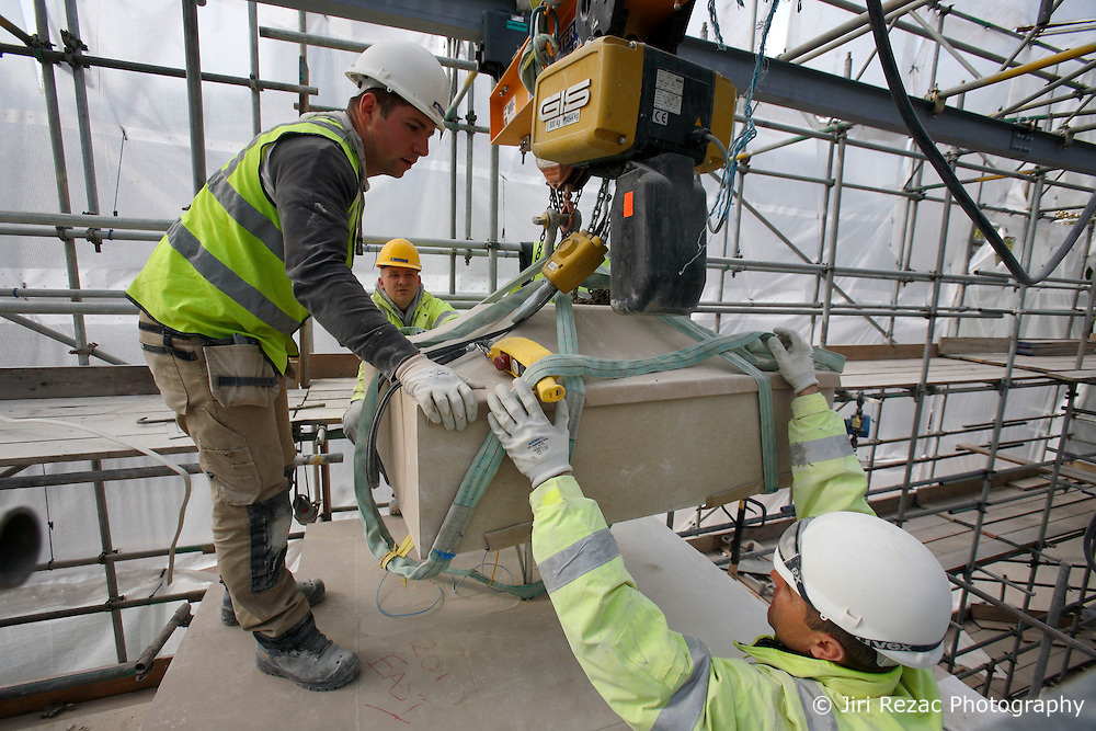 UK ENGLAND LONDON 5MAY12 - Stonemasons Marek Serafin, Marek Mozer and Kluba Grzegorz of Poland put the last stone into place at the RAF Bomber Command memorial construction site in Green Park, central London...RAF Bomber Command found especial fame during World War II, when its aircraft were used for devastating night-time air raids on Germany and occupied Europe, principally the former, their bombing raids causing tremendous destruction of urban areas and factories...Over 12,000 Bomber Command aircraft were shot down during World War II, and 55,500 aircrew were killed, the highest attrition rate of any British unit...jre/Photo by Jiri Rezac..© Jiri Rezac 2012