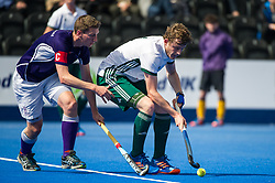 Canterbury's Tom Bean is watched by Tim Warrington of Sevenoaks. Canterbury v Sevenoaks - Men's Hockey League Finals, Lee Valley Hockey & Tennis Centre, London, UK on 23 April 2017. Photo: Simon Parker