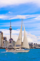 "The ""Pride of Auckland"" sailboat with the Auckland skyline behind, featuring the 328 meter high Sky Tower (the tallest free-standing structure in the Southern Hemisphere), Auckland, New Zealand"
