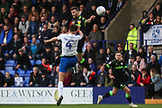 Tranmere Rovers Sid Nelson(4) and Forest Green Rovers Christian Doidge(9) jump for the ball during the EFL Sky Bet League 2 play off first leg match between Tranmere Rovers and Forest Green Rovers at Prenton Park, Birkenhead, England on 10 May 2019.