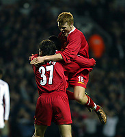 Fotball: Liverpool John Arne Riise (top) celebrates with goalscorers Jari Litmanen and Emile Heskey (hidden)  during the UEFA Champions League match at Anfield.<br />