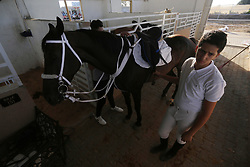 August 4, 2017 - Gaza City, Gaza Strip, Palestinian Territory - Palestinian boys prepares their horses before a jump obstacles championship, in Gaza city on August 4, 2017  (Credit Image: © Mohammed Asad/APA Images via ZUMA Wire)