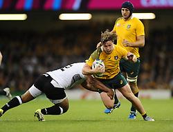 Australia Flanker Michael Hooper avoids the tackle from Fiji Hooker Talemaitoga Taupati  - Mandatory byline: Joe Meredith/JMP - 07966386802 - 23/09/2015 - Rugby Union, World Cup - Millenium Stadium -Cardiff,Wales - Australia v Fiji - Rugby World Cup 2015 - Pool A