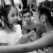 Backstage at a fashion show in Hanoi, Vietnam. With government market reforms and a rapidly growing economy, young urban Vietnamese now have more disposable income to spend on mobile phones, slick motorbikes and up-to-date fashions.
