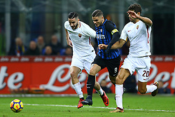 January 21, 2018 - Milan, Italy - Mauro Icardi of Internazionale between Kostas Manolas and Federico Fazio of Roma  during the Serie A match between FC Internazionale and AS Roma at Stadio Giuseppe Meazza on January 21, 2018 in Milan, Italy. (Credit Image: © Matteo Ciambelli/NurPhoto via ZUMA Press)