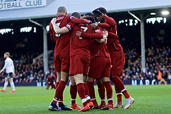 LONDON, ENGLAND - Sunday, March 17, 2019: Liverpool's captain James Milner celebrates scoring the second goal from a penalty kick with team-mates during the FA Premier League match between Fulham FC and Liverpool FC at Craven Cottage. (Pic by David Rawcliffe/Propaganda)
