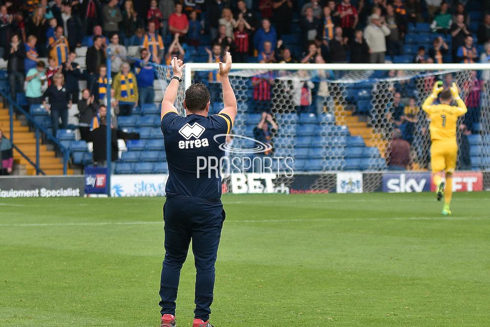 Shrewsbury Town Manager, Micky Mellon applauds the away fans during the EFL Sky Bet League 1 match between Bury and Shrewsbury Town at the JD Stadium, Bury, England on 10 September 2016. Photo by Mark Pollitt.