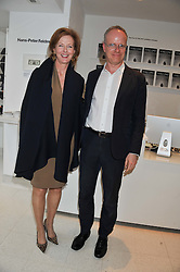 JULIA PEYTON-JONES and HANS ULRICH OBRIST at a private view of Yoko Ono's work - To The Light held at The Serpentine Gallery, Kensington Gardens, London on 19th June 2012.