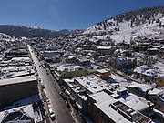 SHOT 3/2/17 11:24:01 AM - Aerial photos of Park City, Utah. Park City lies east of Salt Lake City in the western state of Utah. Framed by the craggy Wasatch Range, it's bordered by the Deer Valley Resort and the huge Park City Mountain Resort, both known for their ski slopes. Utah Olympic Park, to the north, hosted the 2002 Winter Olympics and is now predominantly a training facility. In town, Main Street is lined with buildings built primarily during a 19th-century silver mining boom that have become numerous restaurants, bars and shops. (Photo by Marc Piscotty / © 2017)