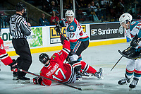 KELOWNA, CANADA - APRIL 14: Calvin Thurkauf #27 of the Kelowna Rockets checks Alex Overhardt #17 of the Portland Winterhawks after the face off on April 14, 2017 at Prospera Place in Kelowna, British Columbia, Canada.  (Photo by Marissa Baecker/Shoot the Breeze)  *** Local Caption ***