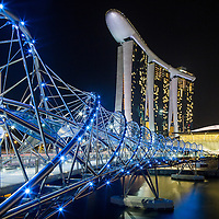 Asia, Singapore, Stainless steel trestles of Helix Bridge near Marina Bay Sands Casino and entertainment complex