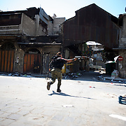 August 10, 2012 - Aleppo, Syria: A Free Syria Army (FSA) fighter shoots towards government's snipper positions in Babar Nassar, a small neighborhood in the old citadel of Aleppo...The Syrian Army have in the past week increased their attacks on residential neighborhoods where Free Syria Army rebel fights have their positions in Syria's commercial capital, Aleppo. (Paulo Nunes dos Santos/Polaris)