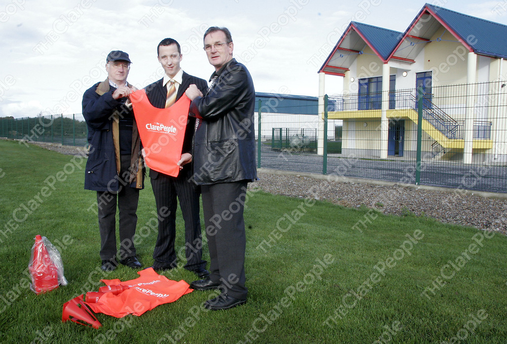 The Clare People's Jamie Leonard presents Clarecastle's Greg Fogarty - Secretary and Pascal Russell- Chairman with bibs, bottles and cones during the week.<br />