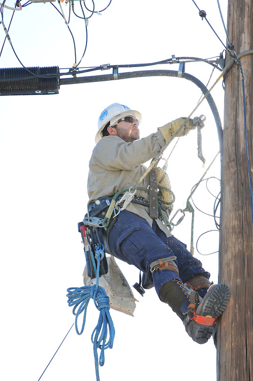 Tucson Electric Power lineman getting ready to bring 200 amp service to my house.