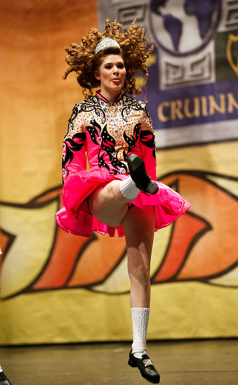 """Belgian Irish Dancer Alicia Bellemans, on the the stage. She got to Glasgow for The 46th annual World Irish Dancing Championships at the Glasgow Royal Concert Hall from March 20th- 27th 2016. From Brussels she is the first Belgian to have qualified for the Championships and were not letting the terrorist  attack and airport closures and transport problems beat them to fulfil their passion to compete at Irish Dancing. Alicia said """" We have to do what we love. We won't stop, they won't stop our passion for Irish dancing, we are afraid, but we fight"""". Alicia had to be in Glasgow for her dance slot at 12.30. She has been on the move since 2am and finally got here via Amsterdam.  Picture Robert Perry 23rd March 2016<br /> <br /> Must credit photo to Robert Perry<br /> FEE PAYABLE FOR REPRO USE<br /> FEE PAYABLE FOR ALL INTERNET USE<br /> www.robertperry.co.uk<br /> NB -This image is not to be distributed without the prior consent of the copyright holder.<br /> in using this image you agree to abide by terms and conditions as stated in this caption.<br /> All monies payable to Robert Perry<br /> <br /> (PLEASE DO NOT REMOVE THIS CAPTION)<br /> This image is intended for Editorial use (e.g. news). Any commercial or promotional use requires additional clearance. <br /> Copyright 2014 All rights protected.<br /> first use only<br /> contact details<br /> Robert Perry     <br /> 07702 631 477<br /> robertperryphotos@gmail.com<br /> no internet usage without prior consent.         <br /> Robert Perry reserves the right to pursue unauthorised use of this image . If you violate my intellectual property you may be liable for  damages, loss of income, and profits you derive from the use of this image."""
