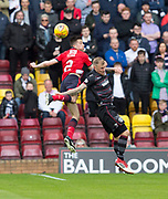 28th April 2018, Fir Park, Motherwell, Scotland; Scottish Premier League football, Motherwell versus Dundee; Cammy Kerr of Dundee heads clear from Ryan Bowman of Motherwell