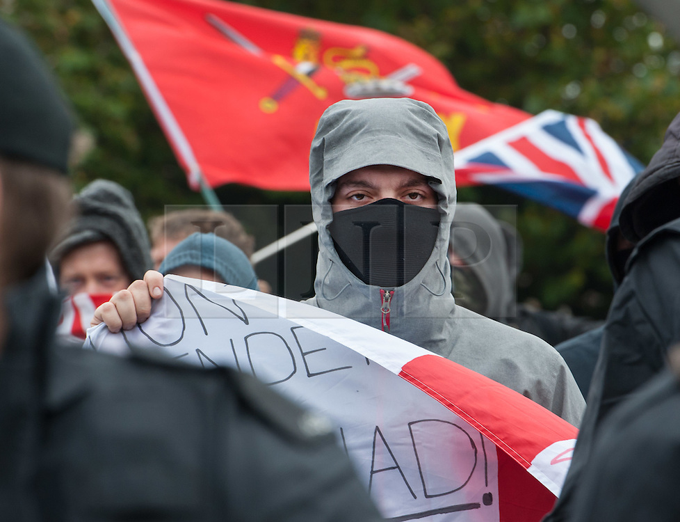 © Licensed to London News Pictures. 17/10/2015. Bristol, UK.  Bristol Patriots.  Bristol Patriots vs Anti-Fascists twin demonstrations in Bristol city centre.  The Bristol Patriots were marching against 'Somali rape gangs' and immigration, and the Anti-Fascists opposed them.  Violence flared between Anti-Fascists and police who made several arrests.  Photo credit : Simon Chapman/LNP