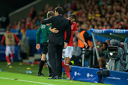 LILLE, FRANCE - Friday, July 1, 2016: Wales' Joe Ledley hugs Wales manager Chris Coleman as he leaves the field following his substitution during the UEFA Euro 2016 Championship Quarter-Final match against Belgium at the Stade Pierre Mauroy. (Pic by Paul Greenwood/Propaganda)