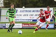 Forest Green Rovers Charlie Cooper(20) passes the ball during the Vanarama National League match between Forest Green Rovers and Wrexham FC at the New Lawn, Forest Green, United Kingdom on 18 March 2017. Photo by Shane Healey.