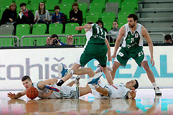 Battle for lose ball during basketball match between KK Union  Olimpija and and KK KRKA Novo Mesto in 20th Round of ABA League, on February 11, 2012, in Arena Stozice, Slovenia. (Photo by Matic Klansek Velej / Sportida)