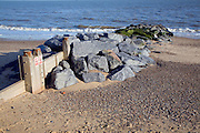 Wooden beach groynes reinforced by rock armour, Southwold, Suffolk, England