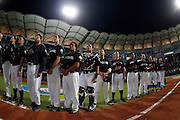 NEW TAIPEI CITY, TAIWAN - NOVEMBER 15:  Members of Team New Zealand are seen in the base path during the opening ceremony before Game 2 of the 2013 World Baseball Classic Qualifier against Team Chinese Taipei at Xinzhuang Stadium in New Taipei City, Taiwan on Thursday, November 15, 2012.  Photo by Yuki Taguchi/WBCI/MLB Photos