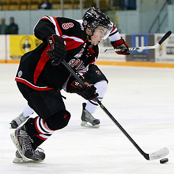 NEWMARKET, ON - Feb 4 : Ontario Junior Hockey League Game Action between the Stouffville Spirit and the Newmarket Hurricanes, Michael Carcone #8 of the Stouffville Spirit Hockey Club skates with the puck during second period game action.<br /> (Photo by Brian Watts / OJHL Images)