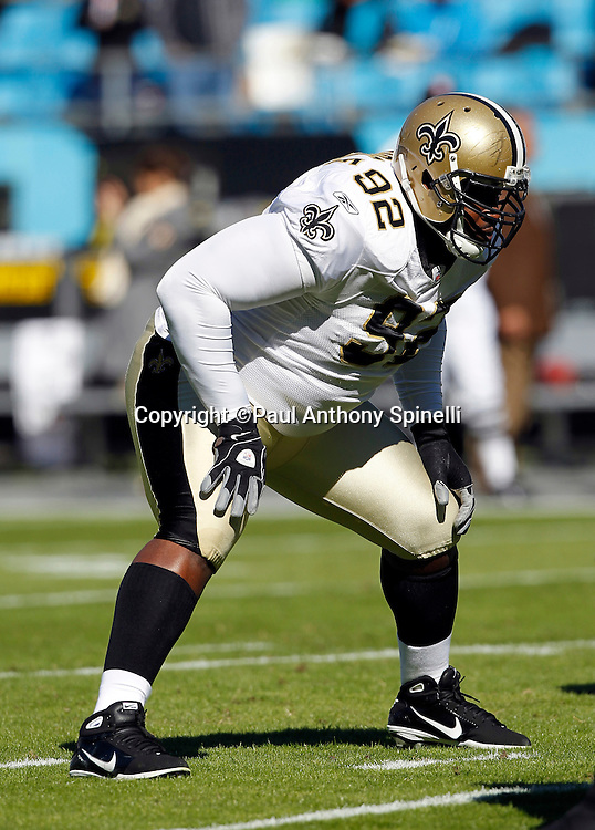 New Orleans Saints defensive tackle Remi Ayodele (92) gets set for the snap during the NFL week 9 NFL football game against the Carolina Panthers on Sunday, November 7, 2010 in Charlotte, North Carolina. The Saints won the game 34-3. ©Paul Anthony Spinelli
