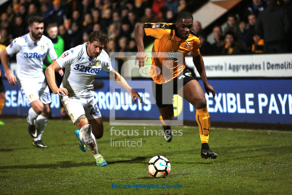 Barry Corr of Cambridge United battles with Gaetano Berardi of Leeds United during the FA Cup match at the Cambs Glass Stadium , Cambridge<br /> Picture by Glenn Sparkes/Focus Images Ltd 07939664067<br /> 09/01/2017