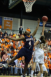 19 March 2010:Philana Greene and Michelle Ketcham work to control a loose ball. The Flying Dutch of Hope College defeat the Yellowjackets of the University of Rochester in the semi-final round of the Division 3 Women's Basketball Championship by a score of 86-75 at the Shirk Center at Illinois Wesleyan in Bloomington Illinois.