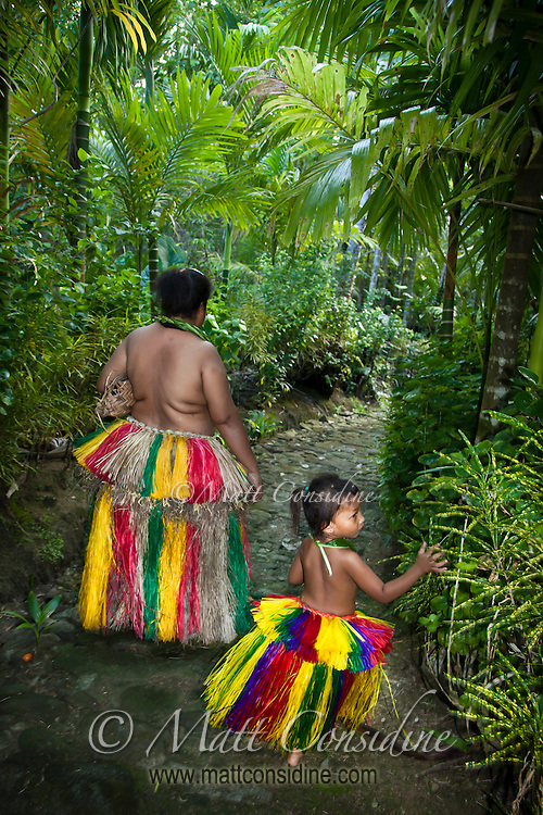 Mother and daughter taking an ancient traditional stone path through the forest to the village house. Yap Micronesia (Photo by Matt Considine - Images of Asia Collection)