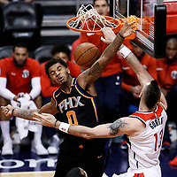 07 December 2017: Washington Wizards center Marcin Gortat (13) dunks the ball over Phoenix Suns forward Marquese Chriss (0) during the Washington Wizards 109-99 victory over the Phoenix Suns, at the Talking Stick Resort Arena, Phoenix, Arizona, USA.