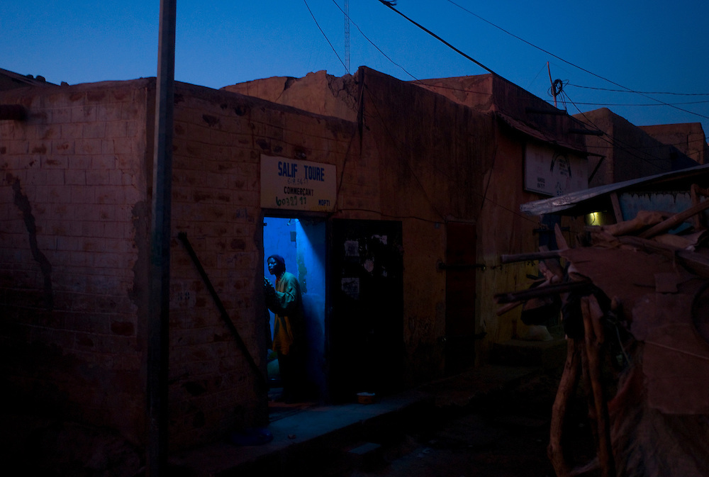 A man inside a store in one of Mopti's alleys. At the confluence of the Niger and the Bani rivers, between Timbuktu and Segou, Mopti is the second largest city in Mali, and the hub for commerce and tourism in this west-african landlocked country.