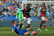 Leicester City forward Jamie Vardy (9)  tackles West Ham United midfielder Pedro Mba Obiang (14)   during the Barclays Premier League match between Leicester City and West Ham United at the King Power Stadium, Leicester, England on 17 April 2016. Photo by Simon Davies.