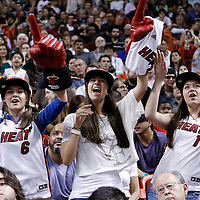 24 January 2012: Miami Heat fans root for the Heat during the Miami Heat 92-85 victory over the Cleveland Cavaliers at the AmericanAirlines Arena, Miami, Florida, USA.