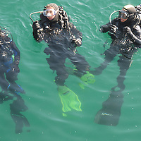 Santa Monica Harbor Patrol Officers Dave Finley, Jared Kingsbury and Nick Kartychok participate in a scuba drill on Friday, December 9, 2011.
