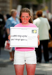 Repro Free: 26/06/2013<br /> Elaine Crossan (12) from Rathfarnham pictured delivering a postcard to Oireachtas members reminding them of the Government&rsquo;s promise to publish legislation to protect young people from using cancer-causing sunbeds. The Irish Cancer Society launched a national campaign calling on Government to publish the long-awaited legislation to regulate sunbed use so that children and young people are protected from the risk of developing skin cancer. There is currently no regulation of sunbeds in Ireland, meaning that children under 18 and those with very fair skin can use sunbeds without proper warning or supervision. Picture Andres Poveda