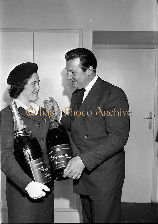 03/08/1962<br /> 08/03/1962<br /> 03 August 1962<br /> Champagne arrives for Horse Show Week Party. Two Lanson Black label Methusalahs (each equal to eight normal bottles) bottles of Champagne were specially flown from Reims, France for Mr Robert West Waffendan's Horse Show Week Party at the Candle Light Restaurant, Shangri-La Hotel, Dalkey, Dublin the next Monday night. Picture shows Hostess Ann Barrett, Aer Lingus, handing over the two bottles to Mr Michael O'Dwyer, owner of Shangri-la Hotel.