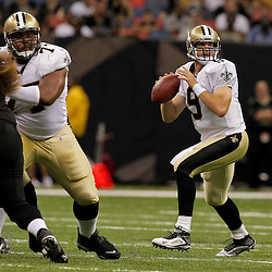 2009 August 14: New Orleans Saints quarterback Drew Brees (9) looks to pass during a preseason opener between the Cincinnati Bengals and the New Orleans Saints at the Louisiana Superdome in New Orleans, Louisiana.