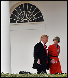 January 27, 2017 - Washington, District of Columbia, U.S. - Prime Minister THERESA MAY and US President DONALD TRUMP walk along the White House Colonnade during her visit to Washington DC. (Credit Image: © Andrew Parsons/i-Images via ZUMA Press)