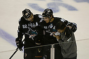 May 26, 2013; San Jose, CA, USA; San Jose Sharks defenseman Justin Braun (61) is helped off the ice against the Los Angeles Kings during the first period in game six of the second round of the 2013 Stanley Cup Playoffs at HP Pavilion.